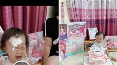 Quế Ngọc Hải hài hước úp bánh sinh nhật vào mặt con gái