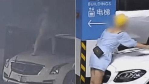 Cãi nhau với bạn trai, cô gái đập phá 9 xe ô tô của người khác