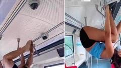 Cố tỏ ra 'cực ngầu' khi thể hiện hít xà trên xe buýt, cặp đôi nhận vô vàn 'gạch đá'