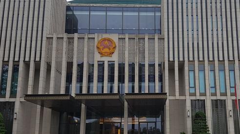 Hình ảnh cờ rủ Quốc tang nguyên Tổng Bí thư Lê Khả Phiêu khắp Thủ đô Hà Nội