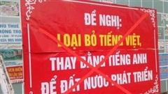 Treo băng rôn đề nghị loại bỏ tiếng Việt, 1 cựu giáo viên bị công an mời lên làm việc