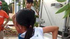 Mẹ trói tay con gái 11 tuổi của mình vào thùng xe tải đánh đập để… 'phạt trộm'