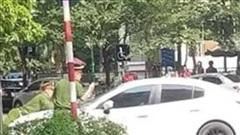 Khởi tố tài xế điều khiển xe hất chiến sĩ Cảnh sát lên nắp capo