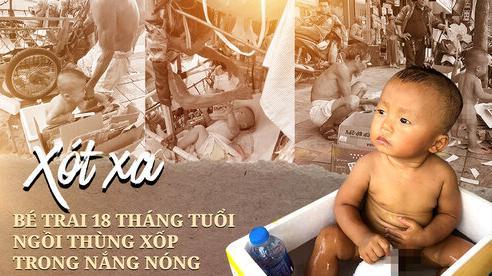 Xót xa bé trai 18 tháng tuổi trần truồng cả ngày ngoài đường bên tấm biển 'cháu không có bố mẹ' giữa nắng nóng 40 độ C ở Hà Nội