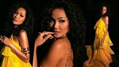 H'Hen Niê tóc xù đẹp hoang dại diện váy vàng rực rỡ khiến fan 'điêu đứng'