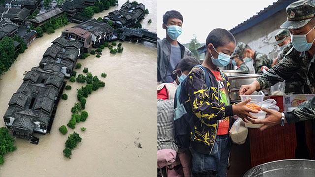 Lũ lụt kinh hoàng tại Trung Quốc đúng lúc dịch Covid-19 bùng phát: Nhà cửa chìm trong biển nước, dân xếp hàng dài nhận tiếp tế