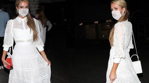 'Nữ thừa kế hụt' Paris Hilton bị ném đá vì đeo khẩu trang đính đá xuyên thấu có cũng như không