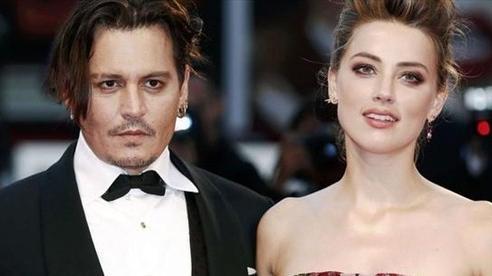 Johnny Depp mong vợ cũ nhận quả báo vì ngoại tình