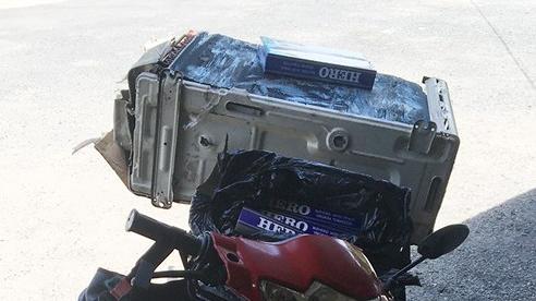 Giấu thuốc lá lậu trong cục nóng máy lạnh