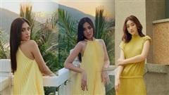 Đỗ Mỹ Linh - Tiểu Vy say đắm với váy đầm xếp pli rực rỡ như thiên thần