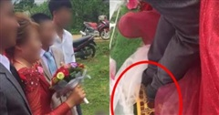 Chú rể liên tục lấy váy cô dâu che chắn khi chụp hình, ai dè giấu giếm một 'bí mật' đằng sau