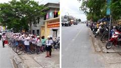 Phụ huynh Nam Định khiến dân tình xuýt xoa khi đỗ xe ngay ngắn kéo dài cả cây số chờ con, bất ngờ hơn là thái độ của học sinh