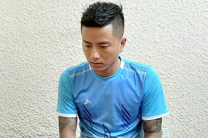 Nguyễn Văn Hân tại cơ quan công an - Ảnh: Công an cung cấp/ NLĐ