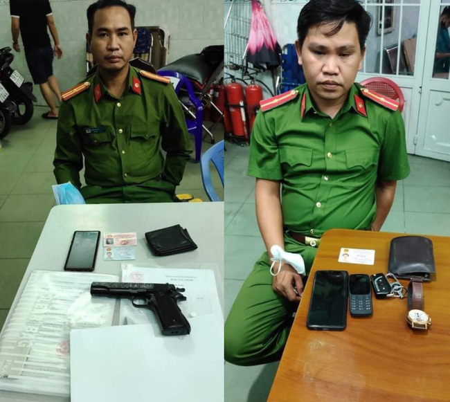 Hai kẻ giảcảnh sát vào nhà dân đọc lệnh bắt người - Ảnh: Dân Việt