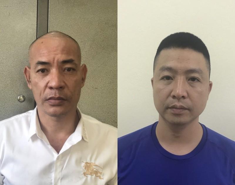 Nguyễn Văn Dũng (áo trắng) và Lê Đức Hùng (áo xanh) tại cơ quan công an. Ảnh: Pháp luật TP.HCM