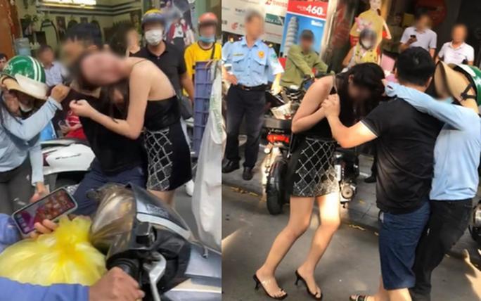 Hình ảnh cô gái bị chặn đường, đánh ghen trên phố được người dân ghi lại - Ảnh cắt từ clip