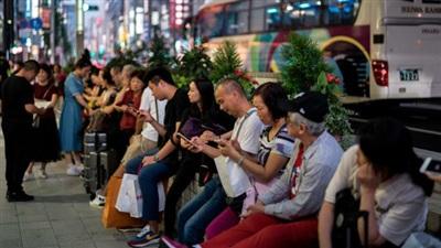 Du khách Trung Quốc tập trung tại khu mua sắm Ginza (Tokyo).