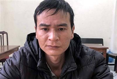 Nghi phạm Nguyễn Xuân Trung tại cơ quan công an.