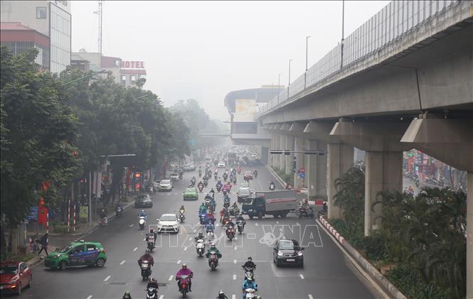 Tất cả các điểm quan trắc ở Hà Nội và các vùng lân cận đều ở mức màu đỏ - có hại cho sức khỏe. Ảnh minh họa: Danh Lam/TTXVN