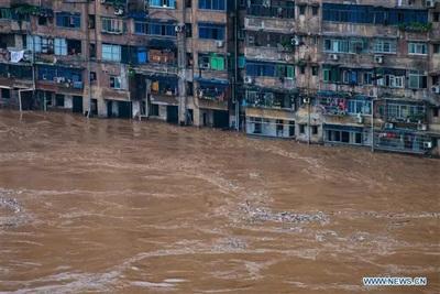 Khu dân cư ở quận Kỳ Giang thuộc TP Trùng Khánh, Tây Nam Trung Quốc, chìm trong nước lũ Ảnh: Tân Hoa Xã