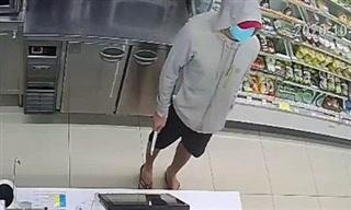 TPHCM: Bắt kẻ cầm dao khống chế nhân viên cửa hàng, cướp tiền