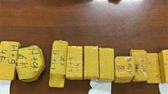 Giám định 51 kg kim loại nghi là vàng lậu