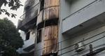 Giải cứu 6 người trong đám cháy nhà cao tầng lúc rạng sáng