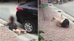 Clip: Nằm lăn lộn khóc lóc vật vã dưới gầm ô tô, người phụ nữ khiến đám đông kinh hãi