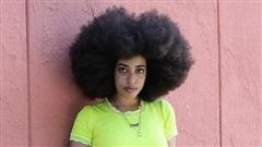 Cô gái Mỹ phá kỷ lục Guiness với mái tóc xoăn tự nhiên lớn nhất thế giới