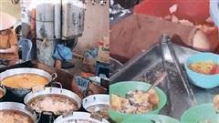 Cảnh dòng người xếp hàng đông kín đợi thưởng thức món bánh rán mặn 'huyền thoại' ở Hà Nội gây xôn xao, có gì mà hot tới vậy?