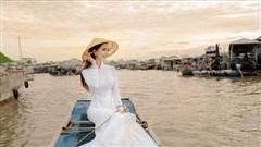 Phan Thị Mơ dịu dàng cùng áo dài và nón lá, thả dáng ngọt ngào trên chợ nổi