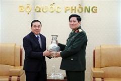 Bộ trưởng Ngô Xuân Lịch tiếp Đại sứ đặc mệnh toàn quyền nước CHDCND Lào tại Việt Nam