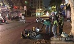 Hai xe máy đối đầu, một tài xế Grab bike tử nạn