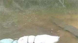 Diễn biến mới nhất vụ thi thể phụ nữ quấn trong bao tải nổi trên mặt hồ ở Sơn La