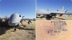MQ-1C Mỹ mang theo tên lửa hạ cánh khẩn xuống ruộng