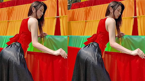 Lê Bống diện áo yếm đỏ, mặc váy đen kín như bưng vẫn để lộ vòng 3 căng tròn gợi cảm