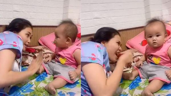 Được dì hai dạy 'đừng có tin đàn ông trên đời', em bé gật đầu lia lịa hưởng ứng, hứa danh dự bằng cách đập tay