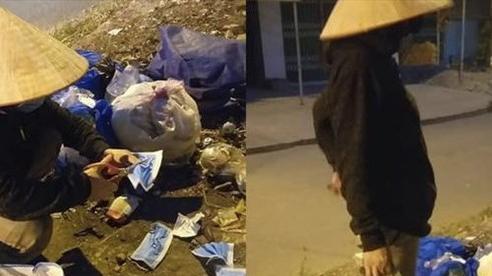 Tấm lòng người phụ nữ nhặt ve chai ngồi cắt đôi khẩu trang y tế vứt ở thùng rác