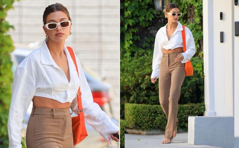Chiếc blouse được cắt ngắn tạo 'cơ hội' để Hailey Bieber khoe trọn vòng eo gợi cảm của mình. Cô nàng khéo léo kết hợp với quần Âu cạp cao, tạo hiệu quả 'hack chân' đáng kể. Không sớm thì muộn, kiểu áo độc đáo này cũng sẽ thành hot trend nhờ ảnh hưởng của cô vợ nhà Bieber.