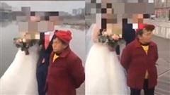 Xin tiền mãi không được, bà cụ liền đứng giữa phá buổi chụp ảnh cưới của cặp cô dâu chú rể, cái kết sau đó mới gây tò mò