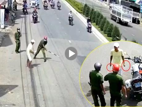 [Video] Đối tượng dùng vũ khí hung hăng chống đối công an