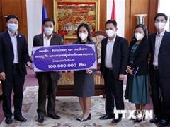 Người dân Lào tiếp tục chung tay cùng Việt Nam chống dịch