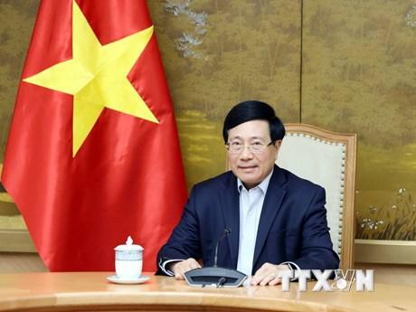Phó Thủ tướng Phạm Bình Minh điện đàm với Cố vấn An ninh quốc gia Mỹ
