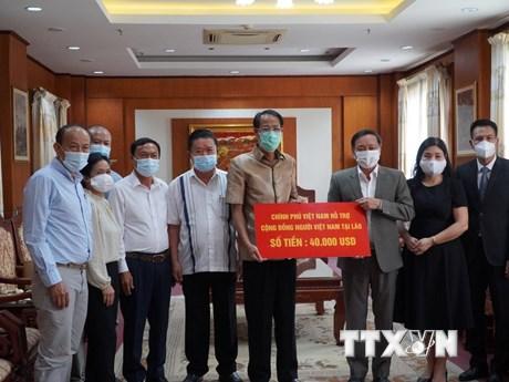 Chính phủ Việt Nam hỗ trợ kiều bào tại Lào chống dịch COVID-19