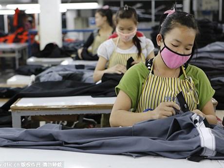 Lào: Các nhà máy may đáp ứng tiêu chuẩn phòng dịch được hoạt động