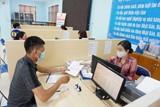 Tạm trú ở Hà Nội có phải về quê xin xác nhận hỗ trợ?
