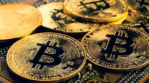 Bitcoin tăng một mạch lên 58.000 USD, cao nhất trong 6 tháng