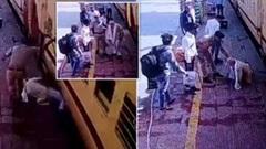 Khoảnh khắc cảnh sát nhanh trí cứu người đàn ông bị tàu hỏa kéo lê