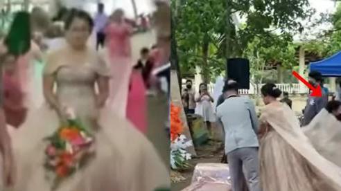 Đám cưới đang cử hành, người đàn ông chui ra từ váy cưới của cô dâu khiến quan khách ngỡ ngàng, bất ngờ hơn là phản ứng của cặp đôi chính