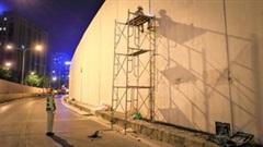 Công nhân làm việc xuyên đêm sửa chữa hầm Kim Liên